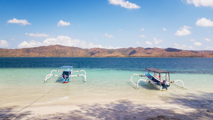 Two tourist boats anchoring on the beach