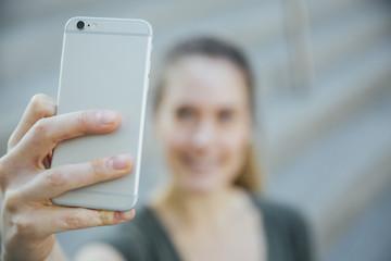 Blonde Woman in Her Twenties Taking A Selfie - University or College Student