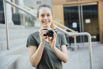 Photography Student Holding an Analog Vintage 35mm Camera