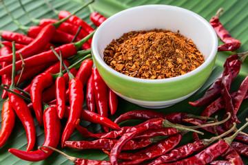 Three type of chili pepper on banana leaf, dry, fresh (raw) and ground