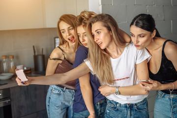 girls take selfy on the phone