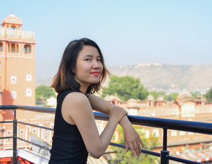 A young Asian woman seeing the old city