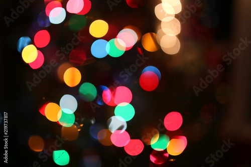 Abstract Background Of Blurred Rainbow Colored Christmas Tree Lights