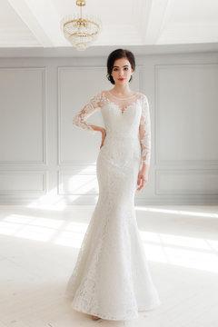 beautiful bride in simple luxurious wedding dress. Full-lenght studio portrait