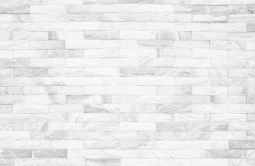 Grey and white brick wall texture background. Brickwork or stonework flooring interior rock old...