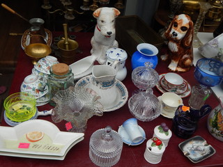 Collections of vintage items on the flea market: tableware, porcelain figurines, candlesticks