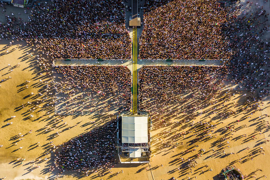 Budapest, Hungary - Aerial shot of crowd in front of a music stage at sunset