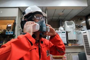Multi-purpose respirator half mask for toxic gas protection.The man prepare to wear Multi-purpose half mask.