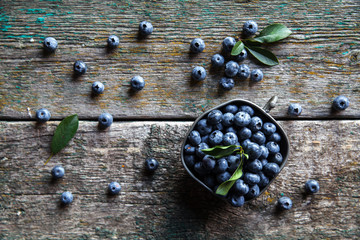 blueberry on a wooden background in a vintage bowl, berries, food