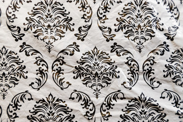 Texture pattern on old oilcloth. Black picture on white background