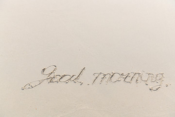 The sea with waves hit the sandy beach in the good morning, with copy space text