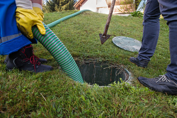 Emptying household septic tank. Cleaning and unblocking clogged drain.