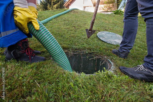 Emptying household septic tank  Cleaning and unblocking