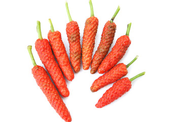 Top view fresh ripe piper longum on white background,Long pepper ,Capsicum frutescens Wall mural