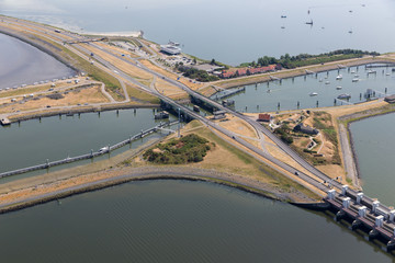 Aerial view Dutch sluices of Kornwerderzand, separation between the fresh water lake IJsselmeer and the salt Wadden Sea