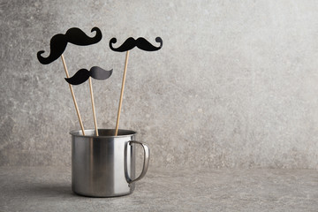 Black photo booth mustache in a cup