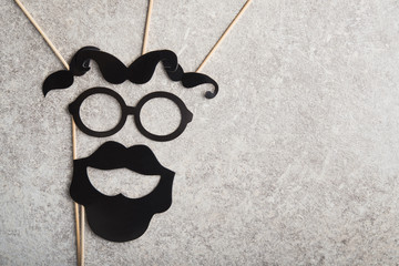 funny faces formed from black photo boots, mustache and glasses