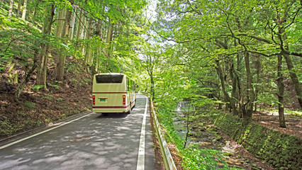 Going up bus to on the road path of countryside mountain