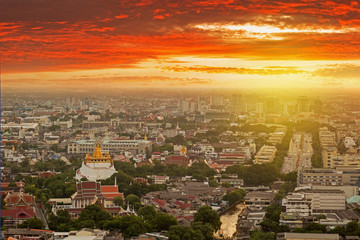 Wall Mural - Bangkok skyline while sunset with Wat Saket temple view.