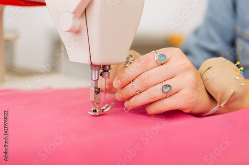Sewing Machine Professional Female Dressmaker Holding A Thread And Extraordinary How To Thread Dressmaker Sewing Machine