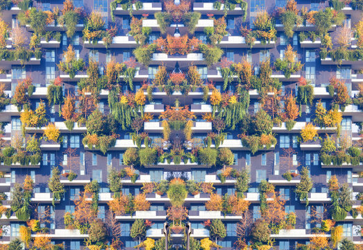 MILAN, ITALY, NOVEMBER 23, 2017 Business District smart city building a part of the economic Zone, modern condo building with trees growing on balconies, Bosco Verticale residential towers.
