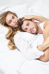 Loving young couple in bed, portrait