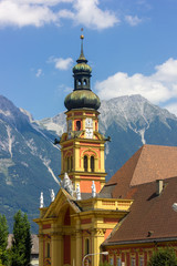 Colorful bell tower of Stift Wilten church on the outskirts of Innsbruck, Austria