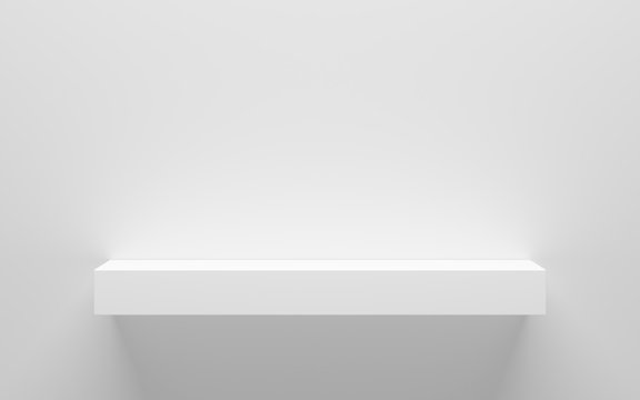empty white shelf on wall with light from the top