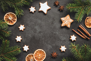 Christmas or New Year 2019 Frame Background. Gingerbread cookies, spices, fir tree and cinnamon on concrete background. Copy space for text
