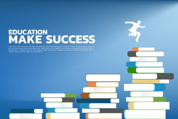 Concept Education make success. Silhouette of businessman jump to higher level of stack of books.