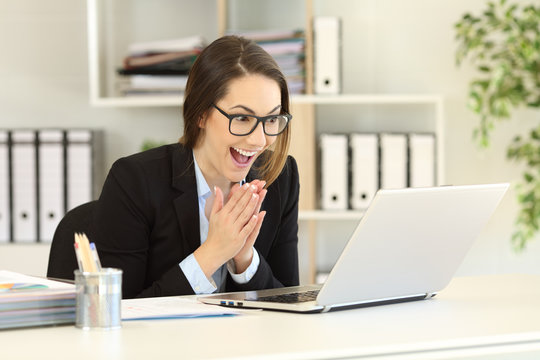 Hopeful office worker watching online content