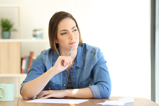 Woman thinking what to write in a letter