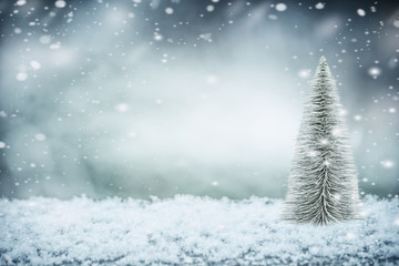 Winter snow background with Christmas tree, front view