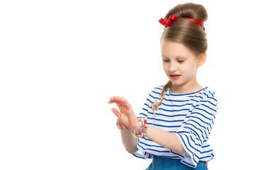 The little girl dresses up.