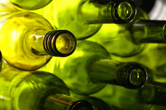 Empty green glass wine bottles isolated on white