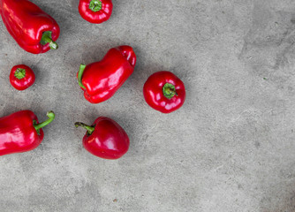 Red peppers on grey concrete background