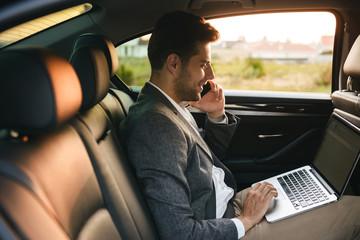 Confident businessman talking on mobile phone