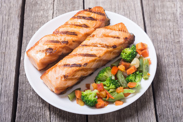 Grilled salmon fish with vegetables