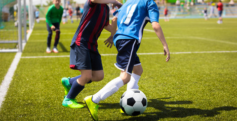 Junior Football Match Competition. Two Young Footballers Running and Competing For Ball. Youth Soccer Tournament