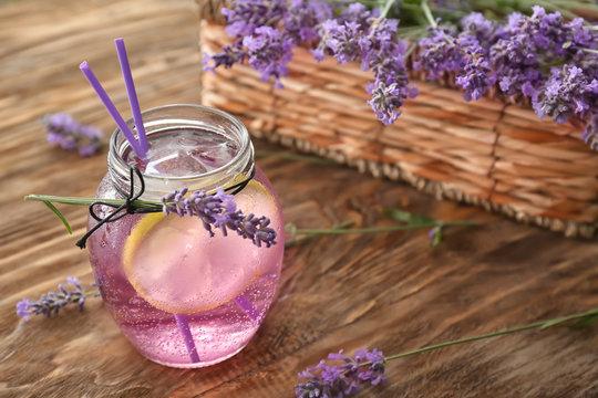Fresh lavender lemonade in glass jar on wooden table
