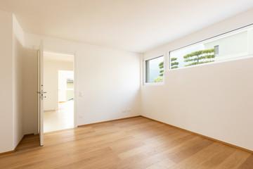 Obraz Empty white room with windows, doors and parquet - fototapety do salonu