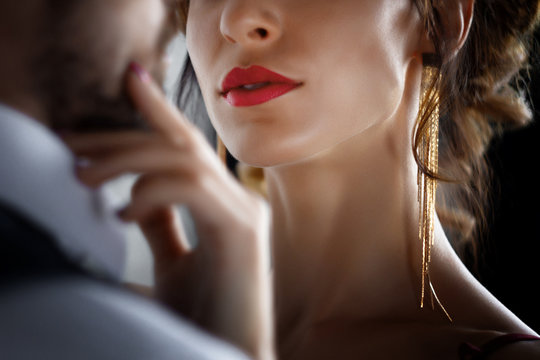 Body part. Sexy elegant luxury woman female with red lips tempts millionaire rich male man in skirt. Sexual issues, sex, relationship, dating concept,