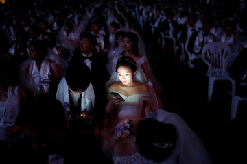 Couples attend a mass wedding ceremony of the Unification Church at Cheongshim Peace World Centre in Gapyeong