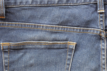The back pocket of the blue jeans.