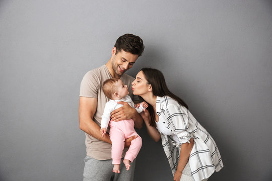 Portrait of a happy young family with their little baby girl