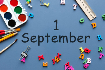 1st September. Image of september 1, calendar on blue background with office supplies. Back to school concept
