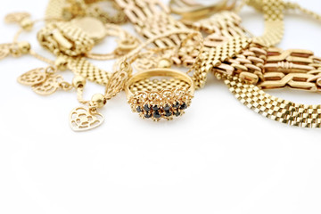 Mixed oriental gold jewelry with copy space on white