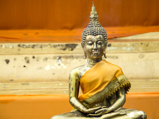 Ancient Golden Buddha in yellow robes