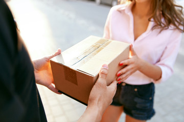 Courier Delivery Service. Closeup Hands Receiving Package