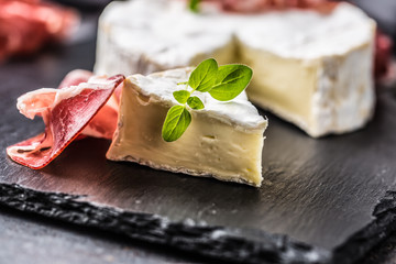 Cheese camambert from prosciutto and oregano herbs.